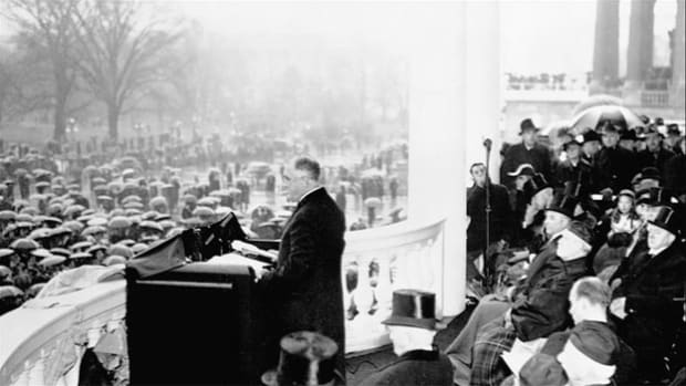 With the country at war at the start of his unprecedented fourth term as president of the United States, Franklin D. Roosevelt delivers a short and somber inaugural address at a simple ceremony without a parade or ball on January 20, 1945.