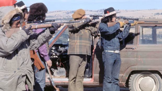 On February 27, 1973, 200 American Indian Movement (AIM) leaders and supporters occupied the South Dakota reservation town of Wounded Knee, site of the infamous massacre of 300 Sioux by the U.S. Seventh Cavalry in 1890. Reporters on the scene relay information about the takeover.