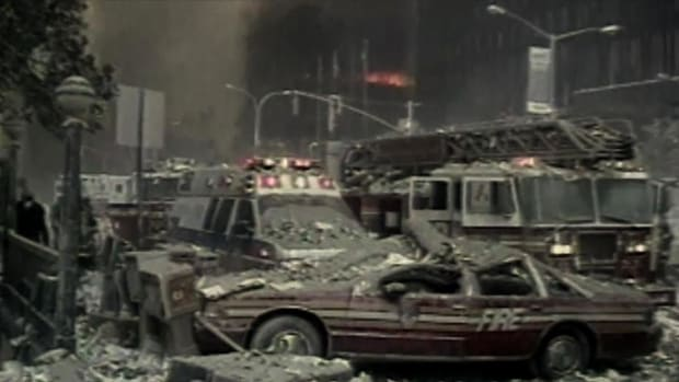 "This video clip provided to ""History Uncut"" was taken immediately after the planes struck the two World Trade Center towers. We glimpse into the harrowing images of Manhattan that are not often shown in news broadcasts: a cameraman's frantic shadow fleeing the scene of disaster, emergency vehicles rendered unrecognizable by debris, and members of the NYPD who attempt to make sense out of the destruction."