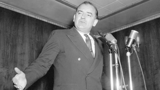 In March 1954, Sen. Joseph McCarthy appears before the Irish Fellowship Club of Chicago to discuss the continuing threat of Communism.