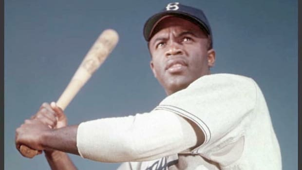 The first African-American to play major league baseball, Jackie Robinson describes his experience in the first few games of the 1947 season, when he was subjected to vicious epithets from other teams and spectators.