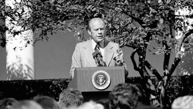 On October 8, 1974, in an address to a joint session of Congress broadcast live over radio and television, President Gerald Ford introduces his WIN, or Whip Inflation Now, program to improve the economy.