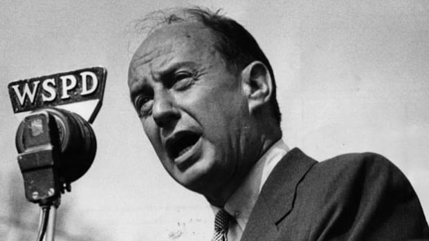 On February 15, 1961, U.S. Ambassador Adlai Stevenson addresses the United Nations General Assembly on the Congo crisis, pledges American support for the U.N.'s peacekeeping efforts and warns against Cold War politics in the civil war.