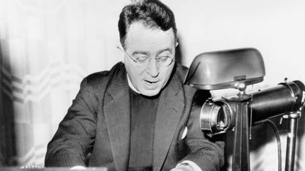 "From the pulpit of his weekly religious radio program, ""Golden Hour of the Shrine of the Little Flower,"" Father Charles Edward Coughlin rails against the WPA and the ""dole"" system. Coughlin's broadcasts were hugely popular during the Great Depression, reaching 16 million listeners, but his increasingly vitriolic and anti-Semitic statements led to the eventual demise of his radio show."