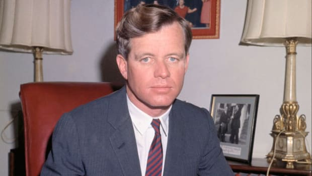 On October 29, 1963, in a recorded meeting with President John F. Kennedy and the National Security Council, Attorney General Robert F. Kennedy voices his concern about supporting the impending South Vietnamese coup to overthrow Ngo Dinh Diem. Secretary of State Dean Rusk, Gen. Maxwell Taylor, and CIA Director John McCone echo RFK's doubts.
