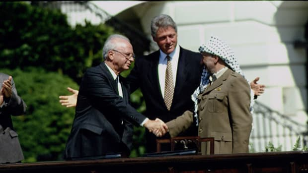 In a ceremony held at the White House on September 13, 1993, Israeli leader Yitzhak Rabin and Yasser Arafat, leader of the Palestine Liberation Organization, signed an agreement to help resolve the Israeli-Palestinian conflict. President Bill Clinton pledges U.S. support in the work that lies ahead.