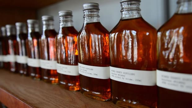 Follow the history of bourbon, and explore the distillation process at the Jim Beam distillery.