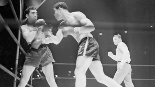 Two years after Max Schmeling's knockout of the undefeated Joe Louis in a non-title bout, they met again on June 22, 1938, for a dramatic rematch at Yankee Stadium. Playing out in live coverage, the match goes to Louis who defeats the German in two minutes and four seconds. Louis was hailed as a hero for all Americans.