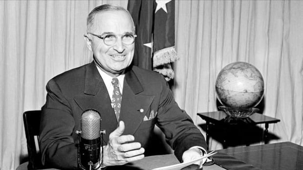 On September 1, 1945, in a radio address to the American people, President Harry Truman announces the unconditional surrender of Japan, formalized aboard the U.S.S. Missouri.