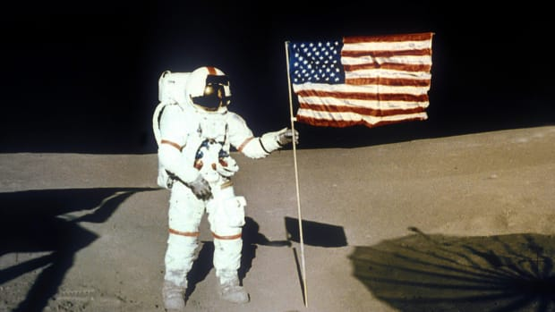 In This Day in History video clip - May 5, 1961: The first American in space - Cape Canaveral, Florida, Navy Commander Alan Bartlett Shepard Jr. is launched into space aboard the Freedom 7 space capsule, becoming the first American astronaut to travel into space. The suborbital flight, which lasted 15 minutes and reached a height of 116 miles into the atmosphere, was a major triumph for the National Aeronautics and Space Administration (NASA).