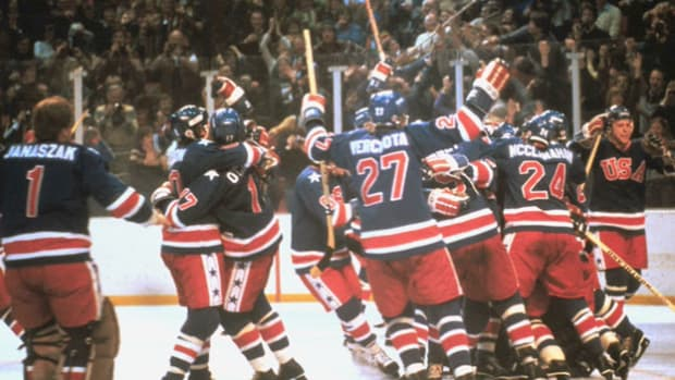 A report from the 1980 Olympic Games in Lake Placid, New York, recaps the astonishing victory of the U.S. men's hockey team over the more experienced Soviets.