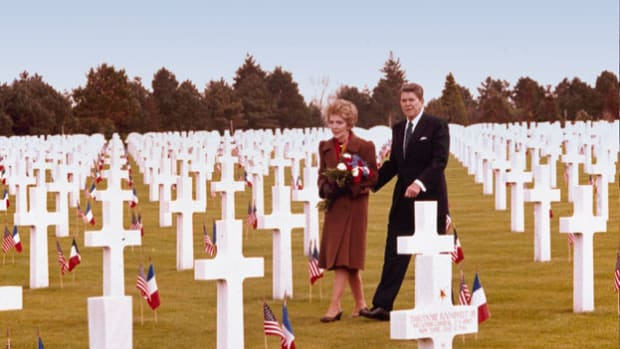 On June 6, 1984, in Normandy, France, President Ronald Reagan honors the heroes of D-Day, a pivotal moment during World War II.