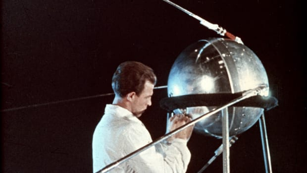 "On this day in 1957, the Soviet Union inaugurates the ""Space Age"" with its launch of Sputnik, the world's first artificial satellite. The spacecraft, named Sputnik after the Russian word for ""satellite,"" was launched at 10:29 p.m. Moscow time from the Tyuratam launch base in the Kazakh Republic. Sputnik had a diameter of 22 inches and weighed 184 pounds and circled Earth once every hour and 36 minutes. Traveling at 18,000 miles an hour, its elliptical orbit had an apogee (farthest point from Earth) of 584 miles and a perigee (nearest point) of 143 miles. Visible with binoculars before sunrise or after sunset, Sputnik transmitted radio signals back to Earth strong enough to be picked up by amateur radio operators. Those in the United States with access to such equipment tuned in and listened in awe as the beeping Soviet spacecraft passed over America several times a day. In January 1958, Sputnik's orbit deteriorated, as expected, and the spacecraft burned up in the atmosphere.On this day in 1957, the Soviet Union inaugurates the ""Space Age"" with its launch of Sputnik, the world's first artificial satellite. The spacecraft, named Sputnik after the Russian word for ""satellite,"" was launched at 10:29 p.m. Moscow time from the Tyuratam launch base in the Kazakh Republic. Sputnik had a diameter of 22 inches and weighed 184 pounds and circled Earth once every hour and 36 minutes. Traveling at 18,000 miles an hour, its elliptical orbit had an apogee (farthest point from Earth) of 584 miles and a perigee (nearest point) of 143 miles. Visible with binoculars before sunrise or after sunset, Sputnik transmitted radio signals back to Earth strong enough to be picked up by amateur radio operators. Those in the United States with access to such equipment tuned in and listened in awe as the beeping Soviet spacecraft passed over America several times a day. In January 1958, Sputnik's orbit deteriorated, as expected, and the spacecraft burned up in the atmosphere."