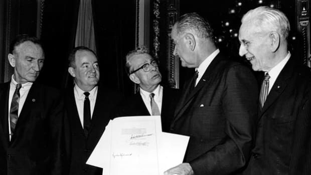 On August 6, President Lyndon B. Johnson signed the Voting Rights Act of 1965 into law. In a speech delivered at the signing ceremony, Johnson describes the historic day as a triumph for freedom as huge as any victory won on any battlefield.