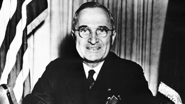 In a May 8, 1945, radio broadcast, President Harry Truman announces the unconditional surrender of Germany, but reminds Americans that the war wages on in the Far East.