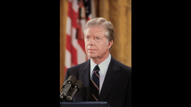 "On July 15, 1979, with gasoline prices skyrocketing, President Jimmy Carter delivers his fifth speech on the energy crisis since taking office. He seeks to make an impact by focusing not just on the energy problem but also on the ""crisis of confidence"" facing Americans."