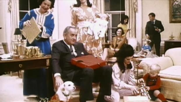 Lyndon and Ladybird Johnson celebrate Christmas morning at the White House in 1968.