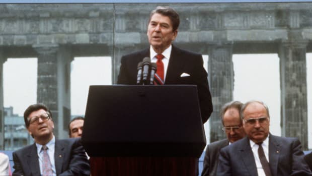 On June 12, 1987, in a speech delivered from the Brandenburg Gate in West Germany, President Ronald Reagan makes one of his most famous statements when he calls on Mikhail Gorbachev to tear down the Berlin Wall.