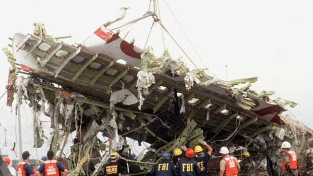 At a press conference on July 17, 1996, officials provide details about TWA flight 800, which burst into flames and plummeted into the Atlantic Ocean soon after takeoff from JFK Airport en route to Paris. Initial reports centered on possible sabotage or missile strike. A lengthy investigation showed a sparking wire in a fuel tank was the likely cause.