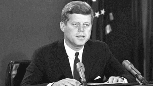 On October 22, 1962, in a national statement, President John F. Kennedy discloses that U.S. spy planes discovered the placement of Soviet offensive missiles in Cuba.