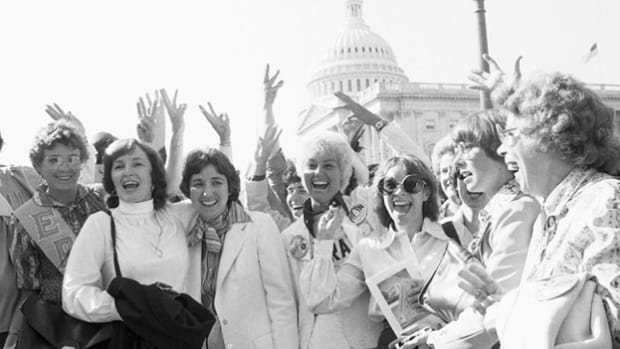 In August 1970, women's rights advocates staged rallies across the nation to commemorate the 50th anniversary of the adoption of the 19th Amendment, which granted suffrage to women. Participants show their solidarity in a group chant.