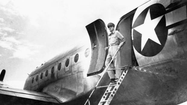 On August 30, 1945, U.S. Gen. Douglas MacArthur arrived in Japan to organize the Allied occupation of the country. NBC coverage of the event includes news of released POWs and the general's good spirits as he descends the ramp of his four-engine C-54.