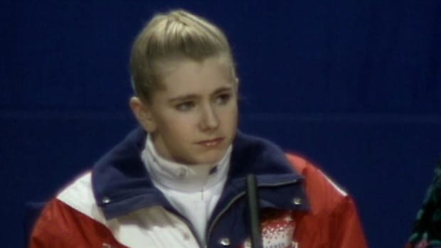 "This video clip from ""History Uncut"" reveals an overconfident Tonya Harding with coach Diane Rawlinson as they tackle tough questions at a press conference held in Lillehammer, Norway during the 1994 Winter Games. The figure skater addresses her relationship with Nancy Kerrigan post-attack, and comments on the scandalous honeymoon video featuring she and ex-husband Jeff Gillooly."