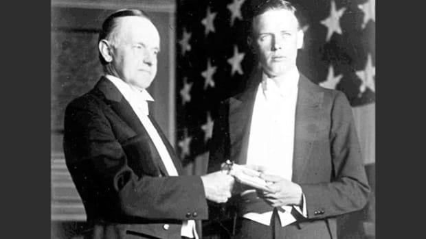 On June 11, 1927, President Calvin Coolidge presented Col. Charles Lindbergh with the first Distinguished Flying Cross medal for his solo nonstop flight across the Atlantic Ocean. At the presentation ceremony, President Coolidge gives opening remarks before Lindbergh's acceptance speech.