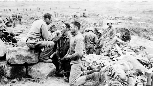 A chaplain's service for U.S. troops on Iwo Jima is broadcast live. On March 26, 1945, after 36 days of bloody battle, the United States took control of the strategically important Japanese island.