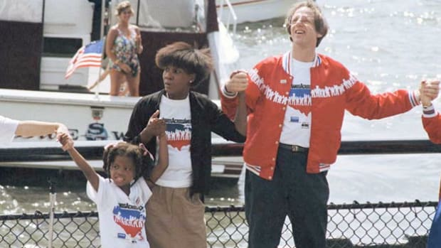On May 25, 1986, more than 5 million Americans came together in a charitable event to raise money for hungry and homeless people in the United States. Spokesperson Ken Kragen addresses the crowd gathered on the southern tip of Manhattan. Despite falling short of the goal to form a bicoastal, 4,125-mile human chain through 17 states, the event raised $20 million.