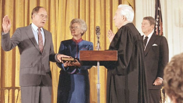 On September 25, 1986, President Ronald Reagan presides over the swearing in of William H. Rehnquist as the 16th chief justice and Aaron Scalia as an associate justice of the U.S. Supreme Court.