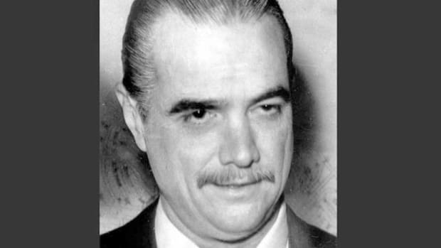 In January 1972, the reclusive billionaire Howard Hughes speaks to reporters and reveals Clifford Irving's book to be a spectacular literary hoax. Irving had convinced his publisher that he'd been commissioned by Hughes to write his biography.