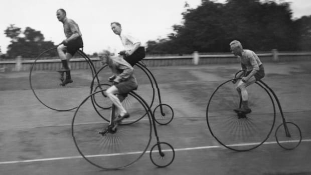 Pedal Your Way Through the Bicycle's Bumpy History; A group of cycling enthusiasts on their Victorian-style penny farthings, training for a race. (Credit: Douglas Miller/Topical Press Agency/Getty Images)