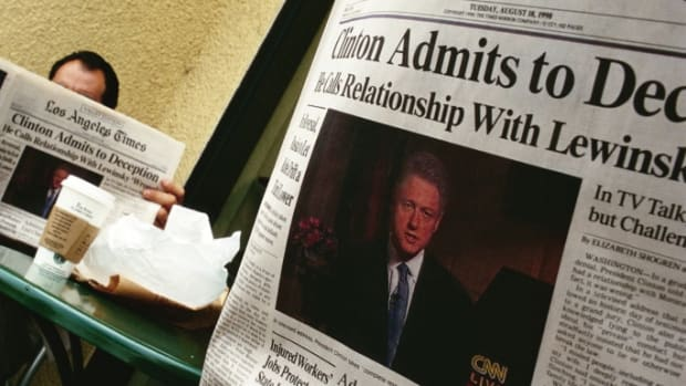 People in a California coffee shop read the Los Angeles Times the day after President Bill Clinton admitted to having a relationship with Monica Lewinsky.