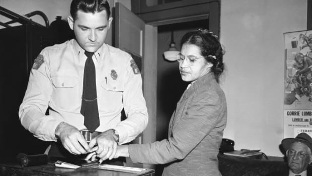 Rosa Parks being fingerprinted by police after refusing to give up her seat on the bus to a white man. (Credit: Gene Herrick/AP/REX/Shutterstock)