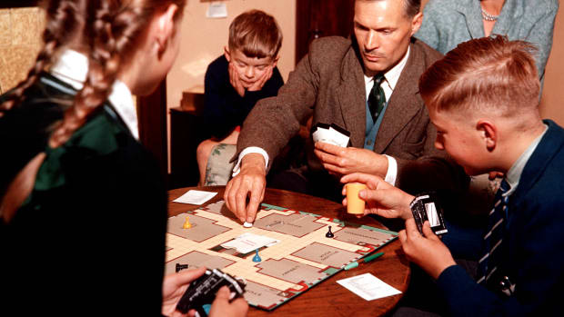 classic-collection-page-95-1048123-1957-family-seated-in-a-living-room-playing-cluedo