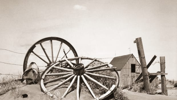 great-depression_dust-bowl_wagon-wheels-against-barbwire-fence_corbis-2