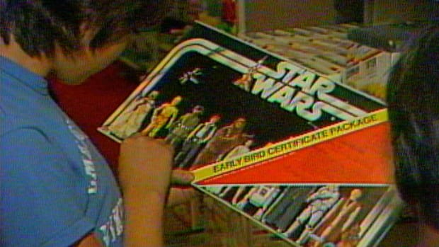 "See how a galaxy far, far away prompted an unprecedented rush for holiday toys in this scene from ""Christmas Through the Decades: The '70s."""