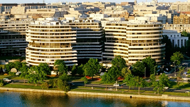 1964-1971, Washington, DC, USA — The Watergate Complex is an office-apartment-hotel complex in the neighborhood of Foggy Bottom, Washington, DC. It is the site where the infamous burglaries took place that led to the Watergate Scandal and the resignation of President Richard Nixon. It overlooks the Potomac River. — Image by © Hoberman Collection/Corbis
