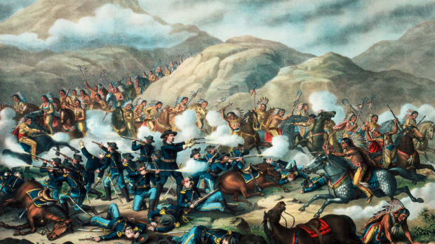 General George Armstrong Custer makes a brave stand with guns in both hands as his soldiers go down in defeat, in a romanticized 1889 lithograph of the Battle of the Little Bighorn, which took place in Montana on June 25, 1876.