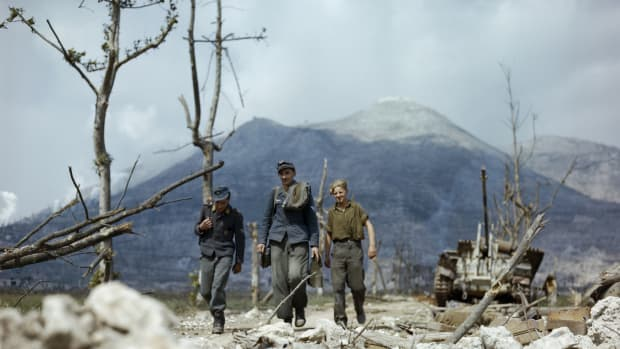 The Campaign In Italy: The Advance On Cassino, May 1944, Three German prisoners walking along the devastated Highway 6, the route to Rome from Cassino, 18 May 1944. (Photo by Capt. Tanner/ IWM via Getty Images)
