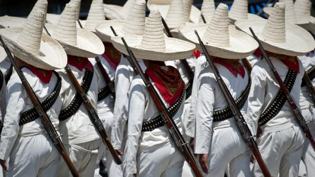 Soldiers of the Mexican Army dressed as revolutionaries, parade during the celebrations of the 200th anniversary of the country's independence at the Reforma Avenuein Mexico City, on September 16, 2010.  AFP PHOTO/Ronaldo Schemidt (Photo credit should read Ronaldo Schemidt/AFP/Getty Images)