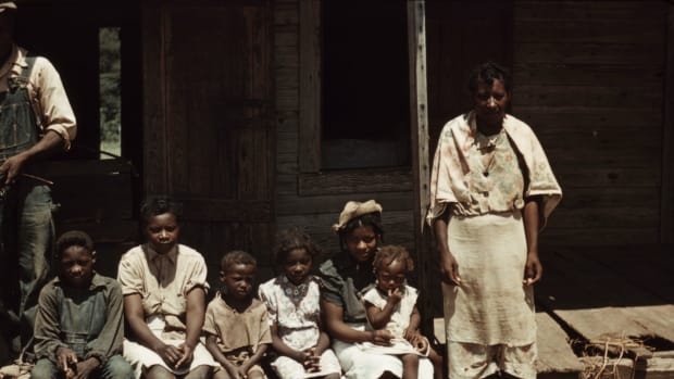 bayou-bourbeau-plantation-a-fsa-cooperative-natchitoches-la-a-negro-family-seated-on-the-porch-of-a-house