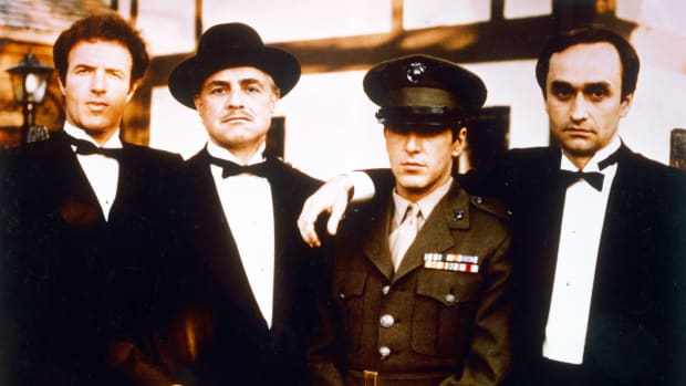 From left: James Caan, US actor, Marlon Brando (1924ñ2004), US actor, Al Pacino, US actor, and John Cazale (1935-1978), US actor, all in black suits, shite shirts and black bow ties except for Pacino who wears a military uniform, pose for a group portrait issued as publicity for the film, 'The Godfather', 1972. The mafia drama, directed by Francis Ford Coppola, starred Caan as 'Santino 'Sonny' Corleone', Brando as 'Don Vito Corleone', Pacino as 'Michael Corleone', and Cazale as 'Fredo Corleone'. (Photo by Silver Screen Collection/Getty Images)