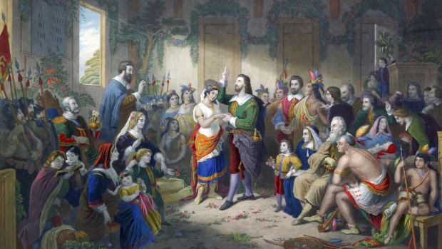 Painting depicting the marriage ceremony of British colonist John Rolfe (1585 – 1622) to Native American Pocahontas (1595 – 1617), the daughter of Chief Powhatan of the Algonquian tribe, in 1614. After a painting by Henry Brueckner, circa 1855. (Kean Collection/Getty Images)