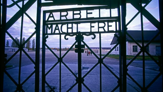 "Dachau, Germany — An entrance gate with the words ""Arbeit Macht Frei"" (""Work Brings Freedom"") at Dachau concentration camp. — Image by © Ted Horowitz/Corbis"