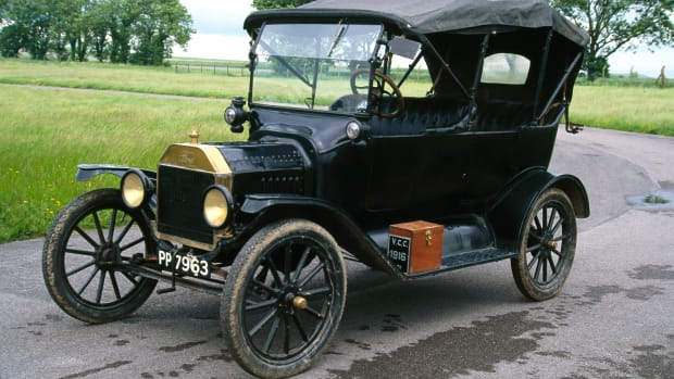 UNITED STATES – SEPTEMBER 19:  The Ford Model T was introduced by Henry Ford (1863-1947) in 1908, and made by the Ford Motor Company in Detroit. By means of true mass production, this car was affordable for far more people than ever before. By 1913 motorised production lines were in use, enabling the Model T to be made in such quantities that, in 1915, a tourer cost half the price it was when first introduced. The new production methods were so speedy that only one paint, japan black enamel, would dry fast enough to prevent problems, hence the remark attributed to Ford that ?Customers can have any color they want so long as it's black?. The Model T was hugely popular, and by the time it was phased out in 1927 over sixteen million vehicles had been made.  (Photo by SSPL/Getty Images)