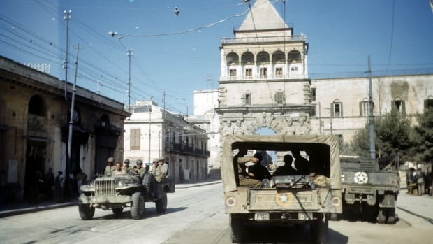 PALERMO, SICILY – AUGUST 22, 1943: A view as Allied forces drive through town after the invasion of Sicily, 5 days after winning the campaign called Operation Husky, during the World War II in Palermo, Sicily, Italy. (Photo by Ivan Dmitri/Michael Ochs Archives/Getty Images)