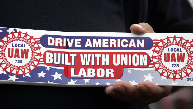 labor-day-auto-worker-with-bumper-sticker