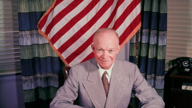 1953, Washington, DC, USA — Washington, DC: President Dwight D. .Eisenhower sitting at his desk. — Image by © Bettmann/CORBIS